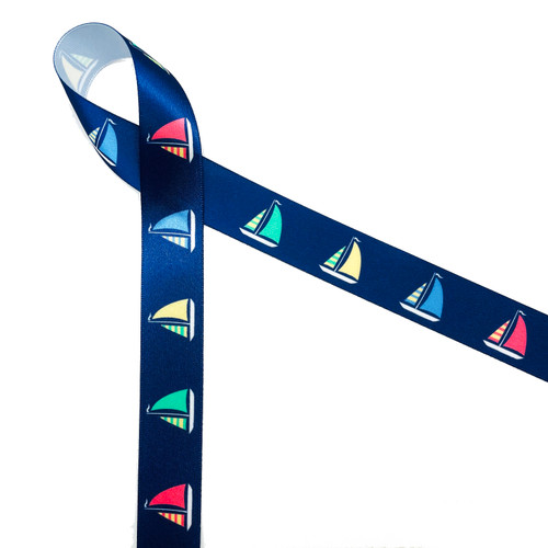 "Sailboats with colorful billowing sails on a navy blue background printed on 7/8"" white single face satin ribbon is a must for Summer seaside and lake side soirees! This is an ideal ribbon for gift wrap, party decor, favors and Summer crafting! All our ribbon is designed and printed in the USA!"