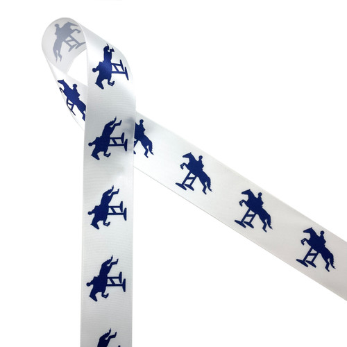 "Horse jumping fences in navy blue printed on 1.5"" white satin ribbon is ideal for the equestrian in your life. This classic design is perfect for pony finals ribbons, hair bows, horse shows, head bands, party decor, floral design and craft projects. Be sure to have this ribbon on hand for quilting and sewing projects too! All our ribbon is designed and printed in the USA"