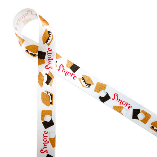 """S'mores in red with chocolate, marshmallows and graham crackers tossed on 7/8"""" white single face satin is such a fun Summer ribbon. This is a fun ribbon for bridal shower favors, baby shower favors, camping parties and barbecues. After all we all need s'more love! Our ribbon is designed and printed in the USA"""