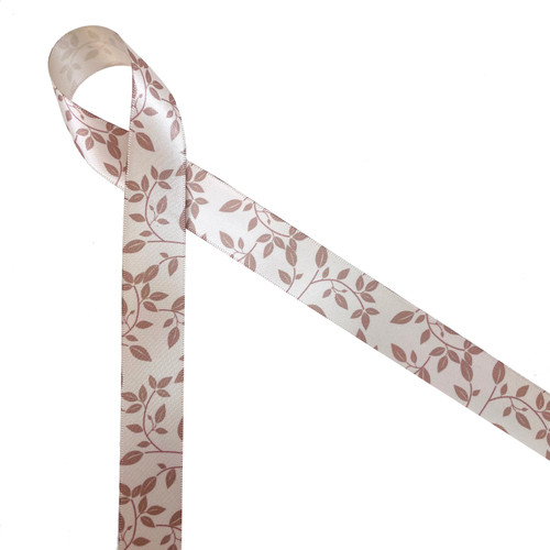 """Tone on tone leaves and vines in tan printed on 7/8"""" iced coffee double face satin ribbon is the epitome of luxury gift wrap, wedding decor, quilting, sewing and crafting. This beautiful ribbon is ideal for wedding table decor, floral design, Fall gift wrap, wedding gift wrap, quilting, sewing and home decor. All our ribbon is designed and printed in the USA"""