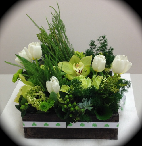 Our shamrocks add just the right touch to this green and white floral arrangement to make it a special delivery for St. Patricks Day!