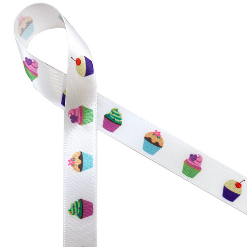 """Pretty little cupcakes with pastel frosting colors pr pink, yellow, blue and green printed on 5/8"""" white single face satin ribbon is the perfect ribbon for cupcake gifts, bakeries and sweet shops. This is a fun ribbon for quilting and crafting too! All our ribbon is designed and printed in the USA"""