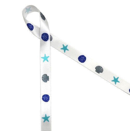 "Shells and Starfish adorn this 5/8"" white single face satin ribbon in shades of blue and gray"