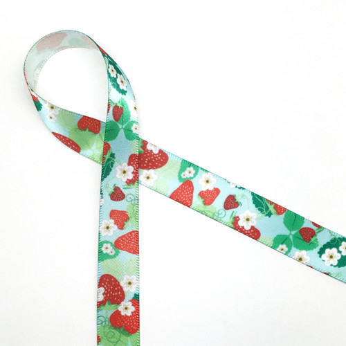 "Strawberry pattern with a light blue background printed on 5/8"" Single Face Satin ribbon on 10 yard spools"