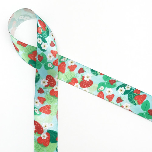 """Strawberries on a blue background with green leaves and white flowers are a wonderful addition to any strawberry themed gift! Printed on  7/8""""white single face satin. Designed and printed in the USA"""
