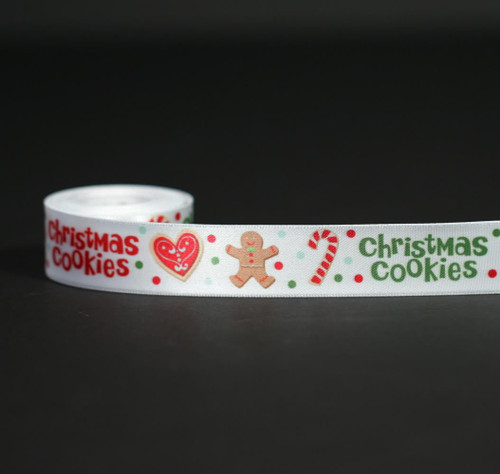 "Christmas Cookies in green and red with hearts, gingerbread men and candy canes on  7/8"" white single face satin ribbon in 10 yard spools."