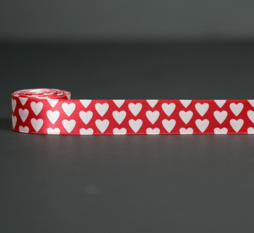 """Pink Valentine hearts on a red background printed on 7/8"""" Lt. Pink single face satin ribbon, 10 Yards"""