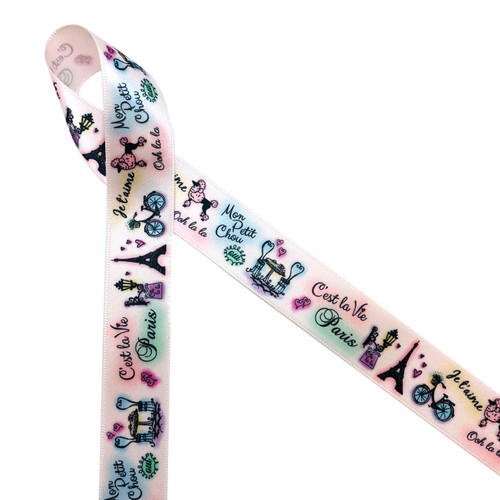 """A Paris Stroll features some of the wonderful elements of a Paris tour. There are shop signs, the French poodle, a tiny cafe and of course the Eiffel Tower. Printed on a beautify 7/8""""l blush ribbon with black, mint and blue accent colors."""