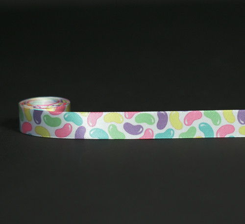 "Jelly beans in pastel colors on 5/8"" white single face satin ribbon, 10 yards."