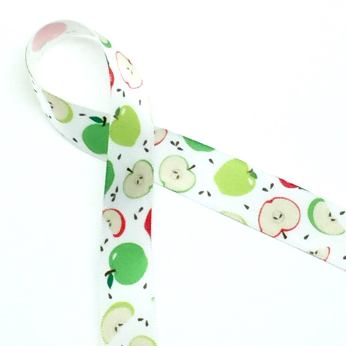 "Apples of red and green tossed with brown apple seeds on 5/8"" white single face satin ribbon on a 10 yard spool"
