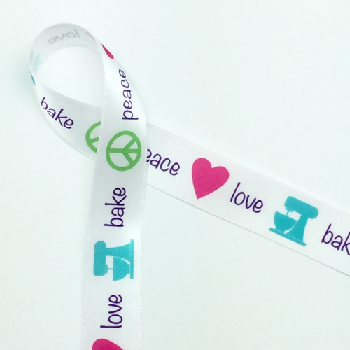 "Peace, Love, Bake in purple lettering with a lime peace symbol, pink heart and teal mixer on 7/8"" White single face satin ribbon, 10 yards"