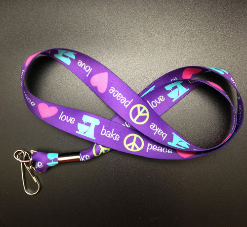 "Peace, Love, Bake Lanyard in purple, pink, teal and lime on 1"" Webbing"
