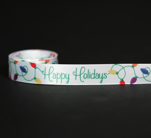 "Happy Holidays in green script with vintage holiday lights in red, orange, purple and blue on 5/8"" white single face satin ribbon makes a fun addition to your small packages or favors."