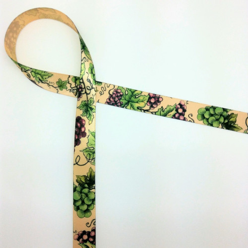 "Grapes in purple with green leaves on 5/8"" raw silk single face satin ribbon offered on a raw silk tan ribbon."