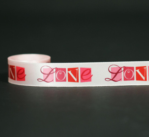 """There is nothing like expressing you LOVE on Valentine's Day! Our love word block ribbon on 7/8"""" white satin will make the statement for you when you tie a gift for that special someone!"""