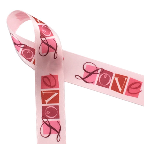 "There is nothing like expressing you LOVE on Valentine's Day! Our love word block ribbon on 7/8"" light pink satin will make the statement for you when you tie a gift for that special someone!"