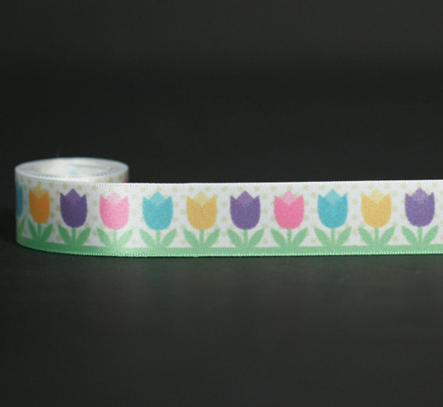 "Spring tulips in pretty pastel colors on a polka dot background growing in the garden on 7/8"" white single face satin ribbon."