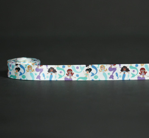 "Mermaids float along with fins in shades of blue, green and purple along with starfish, seahorses and shells on 5/8"" white single face satin ribbon. Perfect for an Under the Sea themed party!"