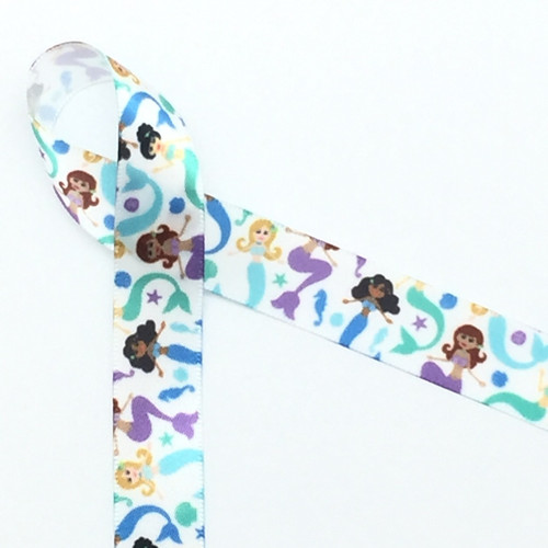 """Mermaids float along with fins in shades of blue, green and purple along with starfish, seahorses and shells on 5/8"""" white single face satin ribbon. Perfect for an Under the Sea themed party!"""