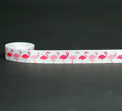"""Flamingos in a row on 5/8"""" white single face satin ribbon is the perfect ribbon to add to the favors at your next tropical themed party!"""