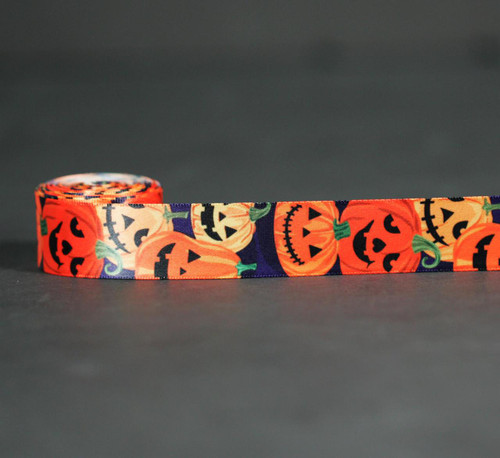 """Jack O'Lanterns tossed on a black background on 7/8"""" white single face satin will make all the little ones smile!"""