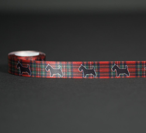 "Sweet little scotty dogs on a red tartan plain are printed on 5/8"" white single face satin ribbon. What an adorable addition to Christmas favors and gifts!"