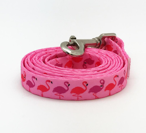 "Our 5/8"" wide dog leash with pink and lavender flamingos on pink webbing is the perfect addition to your pup's tropical wardrobe!"