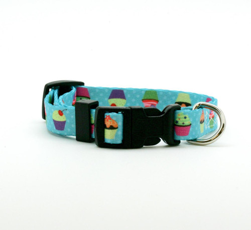 """Our 5/8"""" wide cupcake dog collar is just the sweetest little addition to your pet's wardrobe! These fun cupcakes are decorated with colorful frostings and sprinkles on a turquoise polkadot background! Designed, printed and assembled in the USA"""