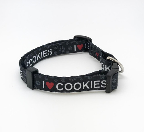 "Doesn't every dog love cookies? This adorable collar in 5/8"" wide webbing with I (heart) Cookies and paw prints is perfect for a medium to small dog. Be sure your pup sports the height of fashion with our fun collar!"