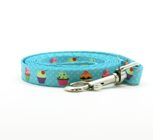 "Take your dog for a walk to the local bakery on the sweetest leash there is and everyone will notice! This sweet leash with cupcakes in a row on 5/8"" wide turquoise webbing is 72"" long and oh so fashion forward!"