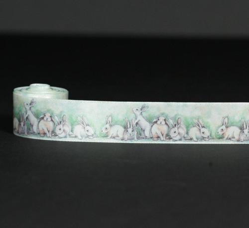 """These beautiful watercolor bunnies are printed on 7/8"""" white single face satin ribbon. The soft and sweet nature of the image is ideal for Spring, Easter and baby events!"""