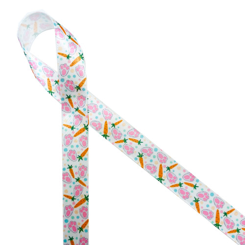 "Bunny paw prints and carrots with blue and pink polka dots printed on 5/8"" white single face satin ribbon will make the cutest tie ever on your Spring and Easter treats, favors and gifts! Designed and printed in the USA"