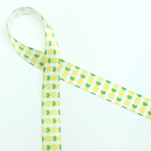 "Pineapples line up in green and yellow on 5/8"" white single face satin ribbon. A long time symbol of hospitality, tying this ribbon on your party favors will let you guest know they are welcome and appreciated!"