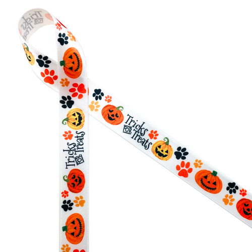 """Tricks for Treats mixed with paw prints and Jack O' Lanterns is the ideal ribbon for making Fido feel special this Halloween! Printed on 5/8"""" white single face satin, this ribbon is available in 10 yard spools!"""