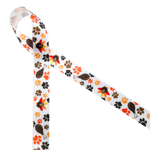 """Pet Thanksgiving ribbon features paw prints in gold, orange, black and brown along with a delicious turkey leg and adorable turkey. Printed on 5/8"""" white single face satin ribbon, this is an ideal ribbon for any one who makes special pet treats!"""