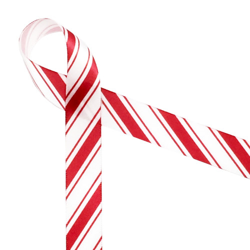 """Our traditional candy cane strips are thin stripes on both sides of a thicker stripe. Printed in red on a 5/8""""  white satin ribbon, this ribbon will make a fun statement on your gifts and sweets!"""