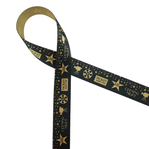 "Be a star on Movie night! Our fun movie themed ribbon features stars, cameras, film reels and ticket stubs in gold on a black background. Printed on 7/8"" dijon gold ribbon, this ribbon will make your party shine!"