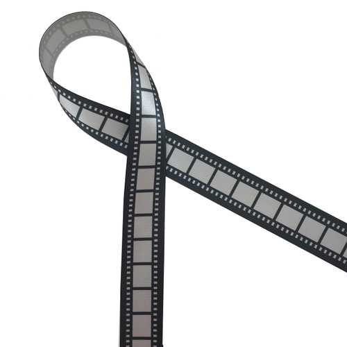 Film strip ribbon in black and silver is the ideal addition to your Movie night party theme! This is a great ribbon for party decor, party favors, floral design, table decor and craft projects with movie themes! Our ribbon is designed and printed in the USA