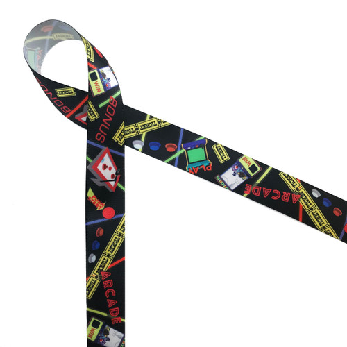 Arcade ribbon featuring all the fun elements of an afternoon of playing games, winning tickets and getting a prize in the claw machine! This is the ideal ribbon for gifts and favors at your next arcade themed party!