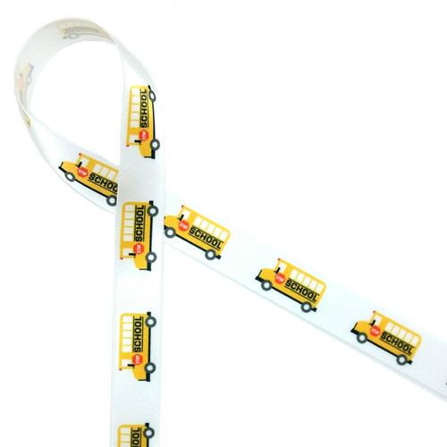 "Yellow school buses lined up on 5/8""  white single face satin ribbon are the ideal accent to the school bus drivers end of year favor!"