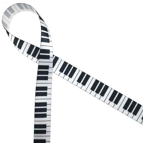 "Keys of the piano in black and white on 5/8"" white single face satin will be the hit of the party favors!"