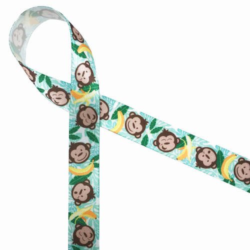 """These little monkey faces and bananas are tossed along a banana leaf and palm frond background. Printed on 5/8"""" white single face satin, these little fellas will add so much fun to your party!"""