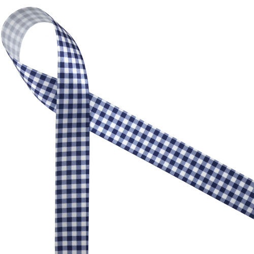 "Navy and white gingham is a classic design for so many occasions! Printed on 7/8"" white single face satin, this ribbon is sure to make a statement on any gift or party decor!"