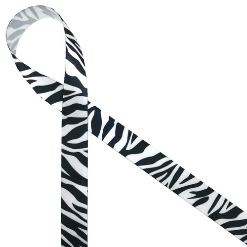 """Zebra stripes in black on 5/8"""" white single face satin appeals to the wild side of life! Be sure to add this ribbon to baby shower gifts, craft projects and favors."""