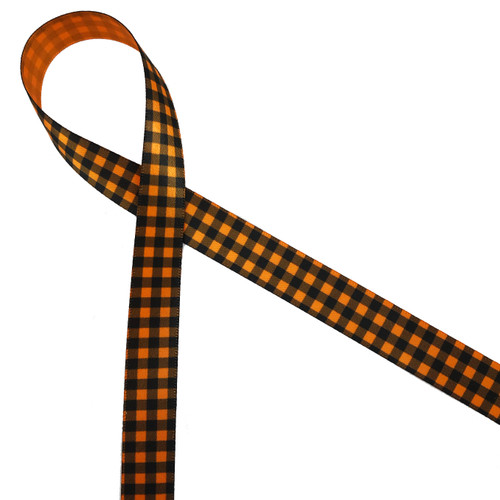 """Black gingham check on 5/8"""" tangerine single face satin ribbon is the ideal tie for all your Fall favors and projects!"""