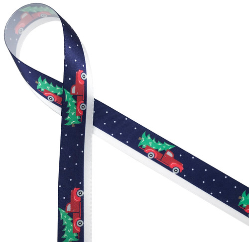 "A vintage red pick up truck delivering the Christmas tree on a snowy night brings back memories of an old fashioned Christmas. Printed on 7/8"" white single face satin, this ribbon is ideal for gifts, decorating and crafting."