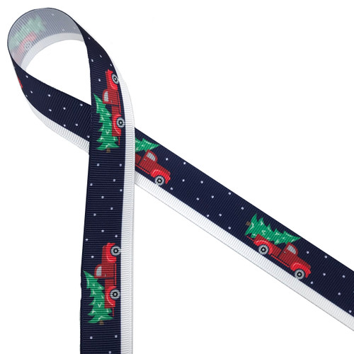 "A vintage red pick up truck delivering the Christmas tree on a snowy night brings back memories of an old fashioned Christmas. Printed on 7/8"" white grosgrain with a navy blue background, this ribbon is ideal for gifts, decorating and crafting."