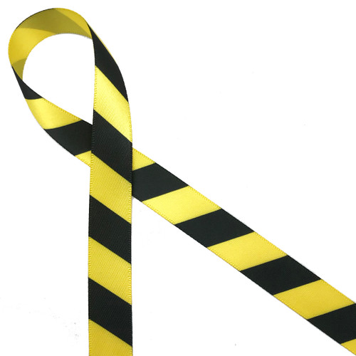 "Black and yellow striped caution tape ribbon printed on 5/8"" daffodil yellow single face satin ribbon makes for a fun addition to lots of part themes!"