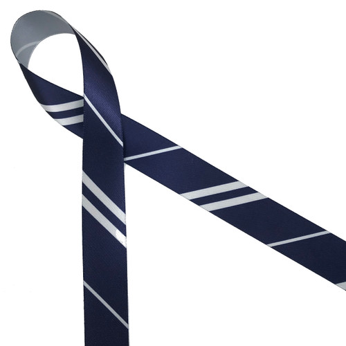 """Wide and narrow stripes of gray and navy blue printed on 7/8"""" gray single face satin ribbon is an ideal addition to any Hogwarts themed party! Designed and printed in the USA"""