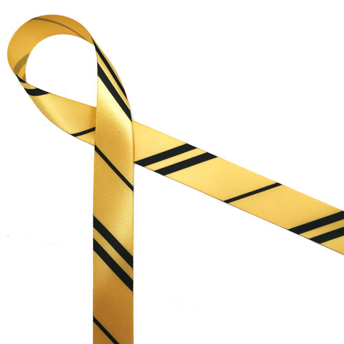 "Wide and narrow stripes of black and gold  printed on 7/8""gold single face satin ribbon is an ideal addition to any Hogwarts themed party! Designed and printed in the USA"
